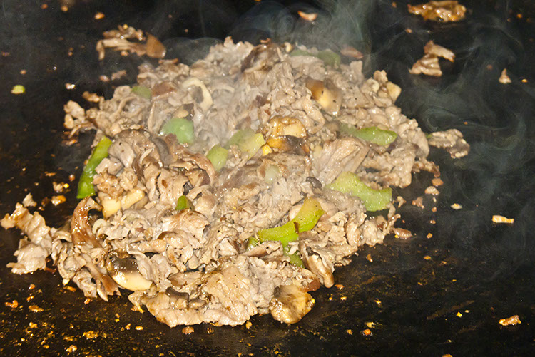 A big ol' pile of delicious sizzles and steams its way to ecstacy on the griddle.