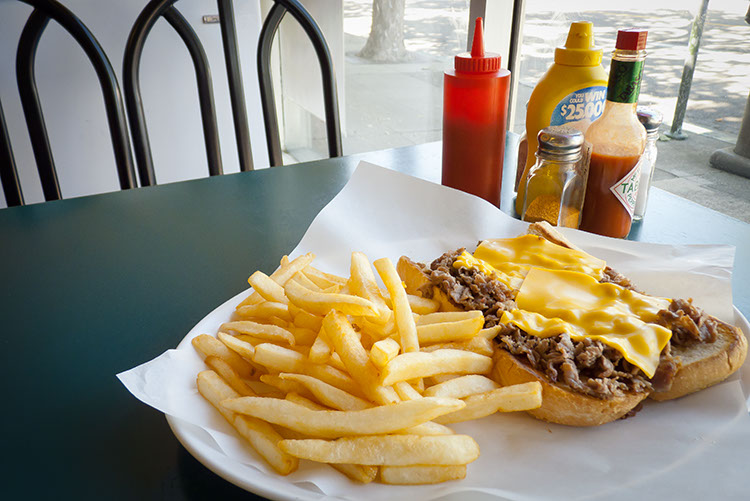 Eat your cheese steak by the window and make passersby jealous.